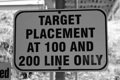 Target Placement at 100 and 200 Line Only. Instructional sign for target shooters to place targets at the 100-yard and 200-yard lines only Royalty Free Stock Images