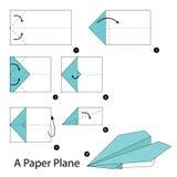 Instructions étape-par-étape comment faire à origami un avion de papier images libres de droits