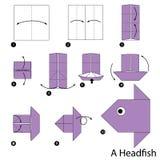Instructions étape-par-étape comment faire à origami un poisson principal illustration libre de droits
