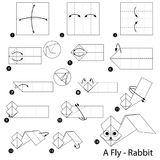 Instructions étape-par-étape comment faire à origami un lapin de mouche Photo stock