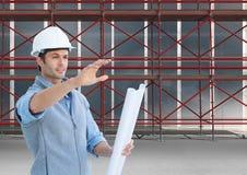 Instructions de givinig d'architectes devant l'échafaudage 3D Photographie stock libre de droits