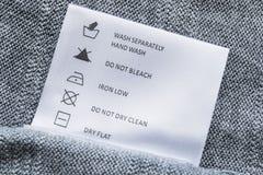 Instructions de lavage photographie stock