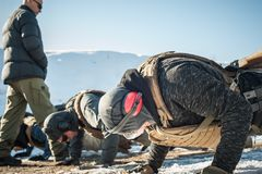 Instructor and army soldiers have hard training and doing push-ups stock image