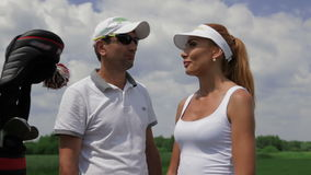 Instructor ask question to the female player about golf stock video footage