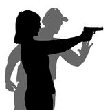Instructor assisting woman aiming hand gun at firing range. Isolated over white background Stock Images