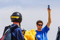 Instructor checking wind Royalty Free Stock Images