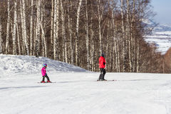 Instructor for children in alpine skiing Royalty Free Stock Image