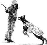 Instructor con un perro Foto de archivo libre de regalías
