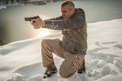 Instructor demonstrate body position of gun shooting on shooting range royalty free stock photos
