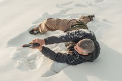 Instructor demonstrate body position of gun shooting on shooting range stock images