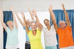Instructor doing exercises with seniors Stock Image