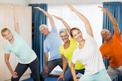 Instructor doing exercises with seniors Stock Images