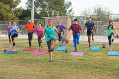 Instructor Exercising with Group Stock Photos