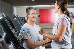 Instructor With Female Client In Health Center Royalty Free Stock Photography