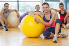 Instructor and fitness class with exercise balls at gym Royalty Free Stock Photo