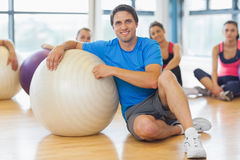 Instructor and fitness class with exercise balls at gym Royalty Free Stock Photography