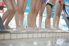 Instructor and group of children doing exercises near a swimming pool.  Royalty Free Stock Images