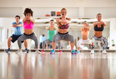 Instructor with group doing exercises for shaping body Stock Photo