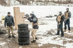 Instructor had firearm tactical shooting training with group of students. On outdoor shooting range. Winter and snow cold season royalty free stock image
