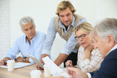 Instructor helping seniors in class stock photography