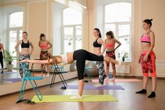 Instructor helps to understand how to do exercise Stock Image