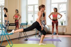 Instructor helps to understand how to do exercise Stock Images