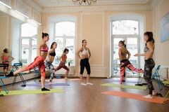 Instructor helps to understand how to do exercise Royalty Free Stock Photo