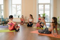 Instructor helps to understand how to do exercise Stock Photography