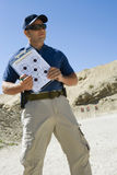 Instructor Holding Clipboard With Target Diagram Royalty Free Stock Photography