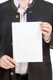 Instructor holds blank sheet of paper in hands Royalty Free Stock Photo