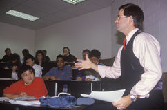 Instructor lecturing to and adult business class Royalty Free Stock Photo