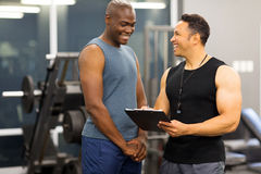 Instructor membership client. Instructor explaining membership form to client in health club royalty free stock photos