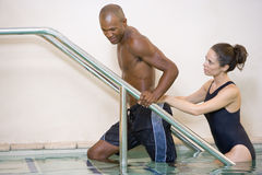 Instructor And Patient Undergoing Water Therapy Royalty Free Stock Photos
