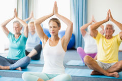 Instructor performing yoga with seniors. During sports class Royalty Free Stock Images