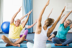 Instructor performing yoga with seniors Stock Images