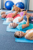 Instructor performing yoga with seniors Stock Image