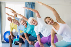 Instructor performing yoga with seniors Stock Photos