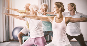Instructor performing yoga with seniors royalty free stock image