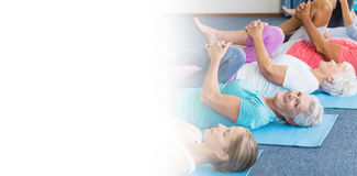 Instructor performing yoga with seniors Royalty Free Stock Images