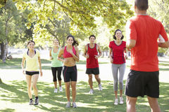 Instructor Running Fitness Boot Camp Stock Photography