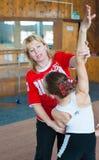 Instructor ruso de los gimnastas de las muchachas Imágenes de archivo libres de regalías