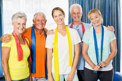 Instructor and seniors with stretching bands Royalty Free Stock Image