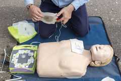 The instructor showing CPR on training doll. Free First Aid Stock Photo