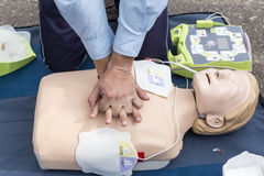 The instructor showing CPR on training doll. Free First Aid
