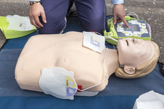 The instructor showing CPR on training doll. Free First Aid Royalty Free Stock Photos