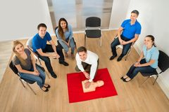 Instructor showing resuscitation technique Stock Photography