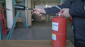 The instructor shows how to use the fire extinguisher royalty free stock photography