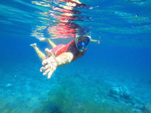 Instructor snorkel give the hand for help, snorkeling lesson, snorkeling instructor. Underwater swimming, summer holiday activity, snorkel man in blue mask Stock Image