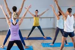 Instructor taking yoga class Stock Photos