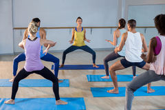Instructor taking yoga class Stock Images